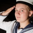 Stock Photo: Sailor saluting isolated