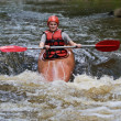 Teenage girl white water kayaking - Foto Stock
