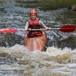 Teenage girl white water kayaking - Stockfoto