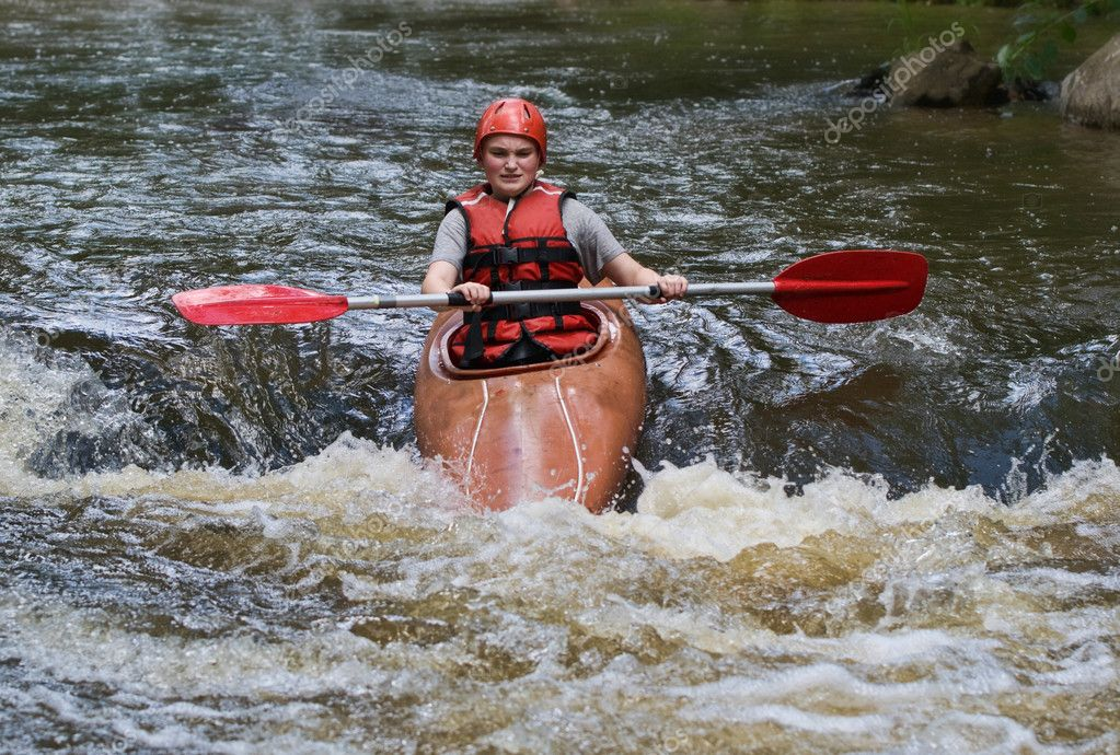 Great image of a teenager girl white water kayaking — Photo #2037322