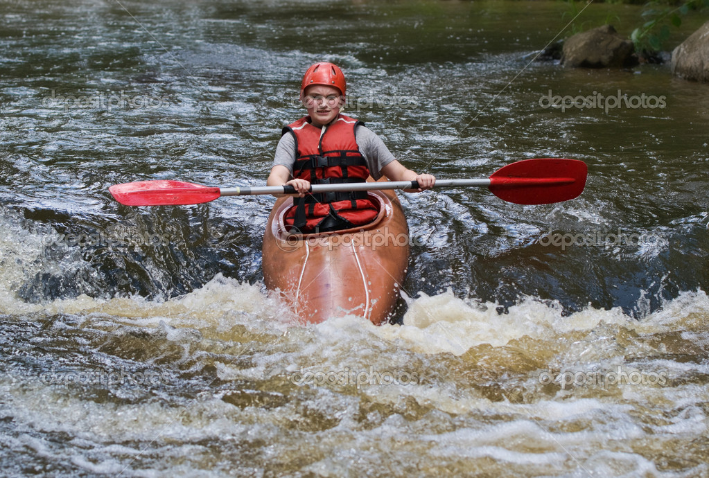 Great image of a teenager girl white water kayaking  Foto de Stock   #2037322