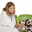 Girl playing doctor with her toys — Stok fotoğraf