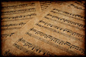 Musical notes on parchment — Stock Photo