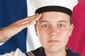 Young sailor saluting — Stock Photo