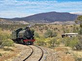 Steam train coming around the corner — Stock Photo
