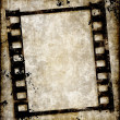 Grungy film strip or photo negative — Stock Photo