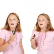 Images of young girl dancing with mp3 — Stock Photo