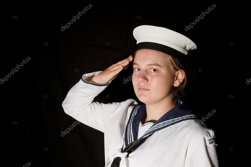 Young female navy seaman saluting on black — Stock Photo #2207116