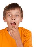 Boy taking a pill — Stock Photo