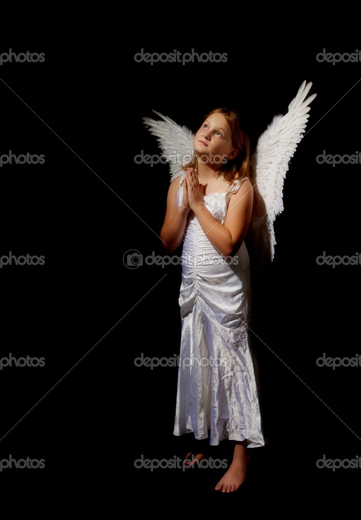 Pure and innocent little angel fairy girl praying —