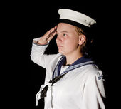 Navy seaman saluting on black — Stock Photo