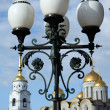 Lantern on a background of a cathedral - Stock Photo
