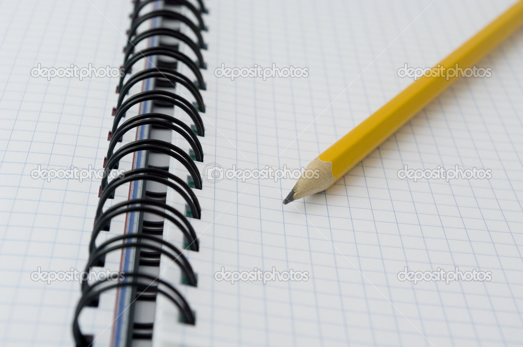 Pencil on opened notebook.  Stock Photo #1049403