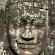 Smiling stone face of Bayon - Stock Photo