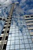 Clouds go into skyscraper's windows — Stock Photo