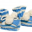 Kids knit baby's bootees — Stock Photo #1090433