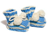 Kids knit baby's bootees — Stock Photo
