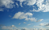 Blue summer sky with clouds — Stock Photo