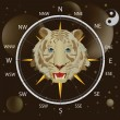Royalty-Free Stock Vector Image: Compass a wind rose and a tiger