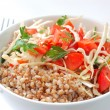 Boiled buckwheat with salad — Stock Photo