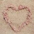 Stock Photo: Heart of sand on beach