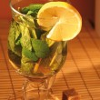 Cup of gren mint tea with lemon — Stock Photo
