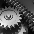 Interlocking industrial metal gears - Stockfoto