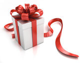 Present box with red ribbon — Stock Photo