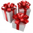 Three boxes with a red ribbon — Stock Photo