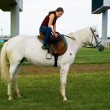 Stock Photo: Girl astride horse on hippodrome