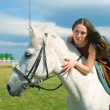 Girl astride a horse on a hippodrome — Stock Photo