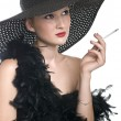 Royalty-Free Stock Photo: Women in black hat and boa with a cigare