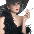 Women in black hat and boa with a cigare - Stock Photo