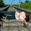 Royalty-Free Stock Photo: Girl laying on a railway