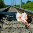 Girl laying on railway — Stock Photo #1062401