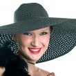 Smiling women in black hat and boa — Stock Photo