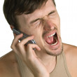 Aggressive young men with cellular phone — Stock Photo