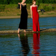 Two barefooted girls — Stock Photo