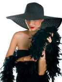 Beautiful smiling women in black hat and — Stock Photo