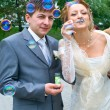 Couple blowing the soap bubbles — Stok fotoğraf