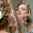 Royalty-Free Stock Photo: Bride against mirror