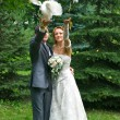 Bride and groom with pigeons - Stock Photo