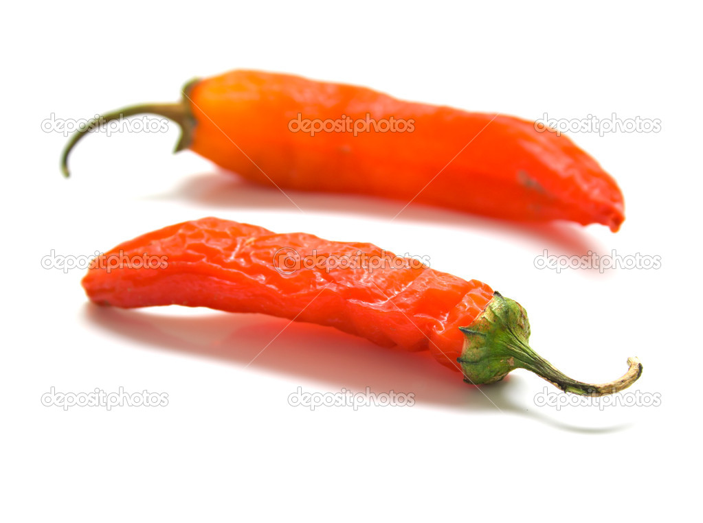 Red peppers on a white background. Isolation, shallow DOF  Stock Photo #1282933