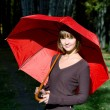 Royalty-Free Stock Photo: Girl with a red umbrella