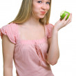 Girl with a green apple — Stock Photo #1360232