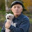 Elderly man with a dog — Stock Photo #1368392