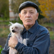 Elderly man with a dog — Stock Photo