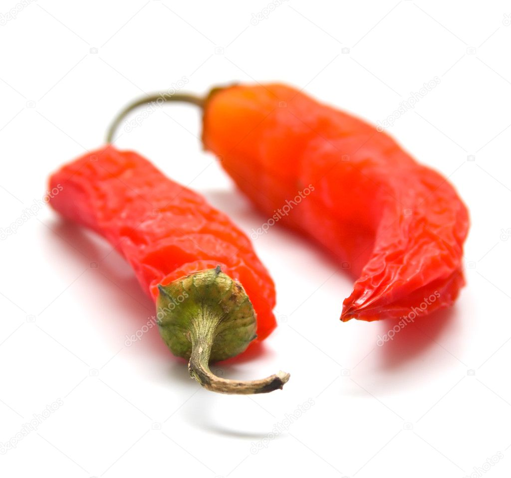 Red peppers on a white background. Isolation, shallow DOF — Stock Photo #1368618