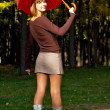 Girl with a red umbrella — Stock Photo