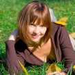 Stock Photo: Happy girl on green grass 2